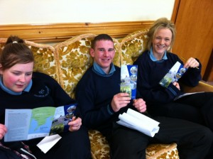 Shannon, Joe and Eimear learning about the work done in St Louis Day Care